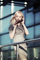 Happy young woman calling on the phone