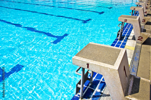 Fotobehang Water Motorsp. Starting platforms with numbers for swimming races.