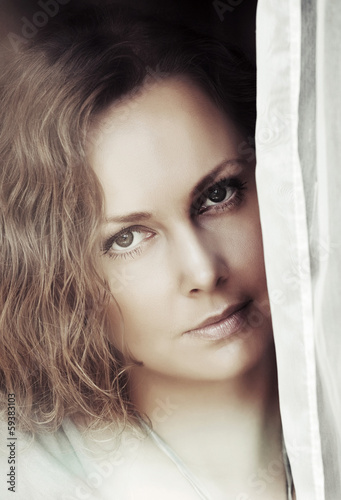 Portrait of beautiful woman looking out the window