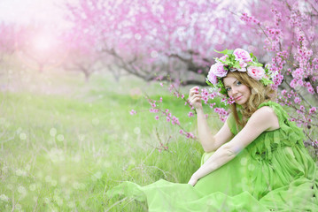 beautiful girl in the flowered garden peach