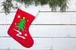 Christmas stocking and pine branches