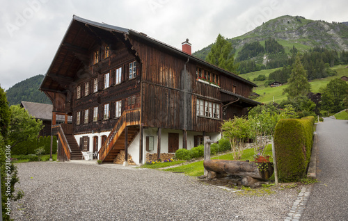 Traditional old farm house in the Gstaad, Swiss Alps