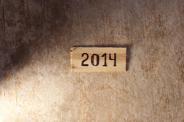 tags with 2014 on a wooden surface