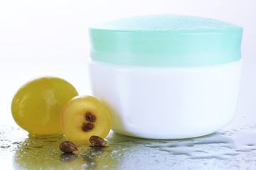 Cosmetic cream and sliced grape, close up