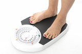 Model Released. Attractive Young Woman on Bathroom Scales
