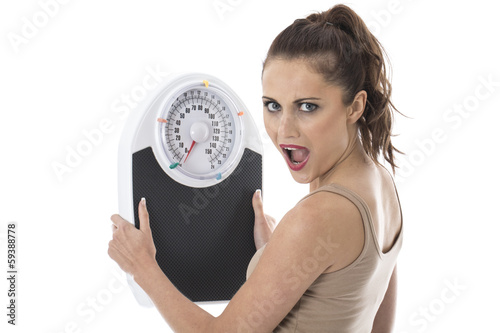 Shocked Young Woman Holding Bathroom Scales
