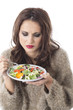 Young Woman Eating Stir Fried Vegetables