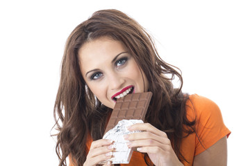Happy Young Woman Eating Chocolate