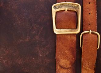 Old leather belts for vintage shabby background skin