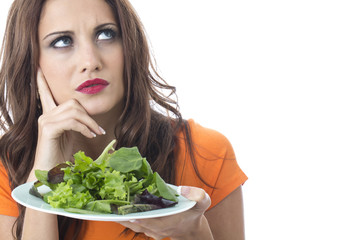 Young Woman Eating Green Leafed Salad
