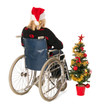 woman in wheel chair with Christmas tree