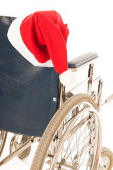 wheel chair with hat Santa Claus
