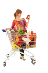 Woman with Shopping cart reading label