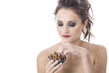 Young Woman Eating Mixed Nuts