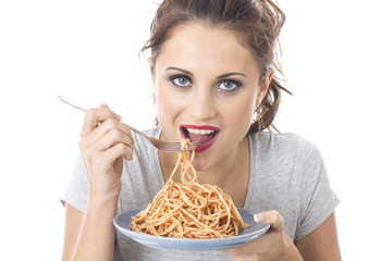 Young Woman Eating Spaghetti