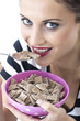 Young Woman Eating Breakfast Cereal