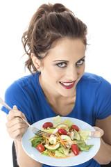 Young Woman Eating Mixed Salad