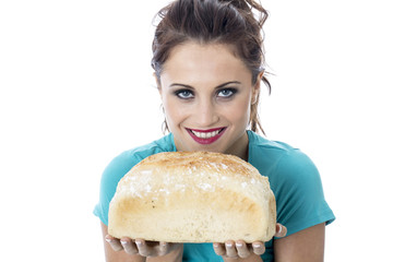 Young Woman Holding a Loaf of White Bread