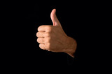 Thumb up on dark background
