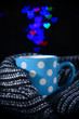 Cup of coffee with plaid on dark background