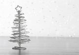 metallic modern christmas tree on wood table