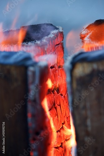 Logs in fire with burning red wood , vertical