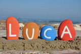 Luca, male name on colourful stones