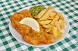 Fish and fries with peas in diner. - 59394722