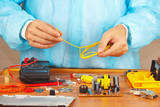 Master repairing electronic hardware in the service workshop