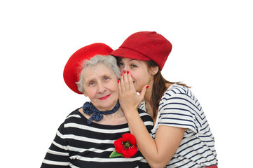 grandmother and her granddaughter whispering