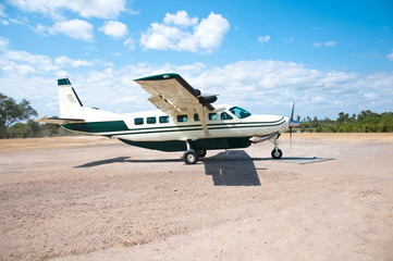 parked airplane on the landing runway in tanzania
