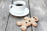 Gingerbread man with coffee on wood