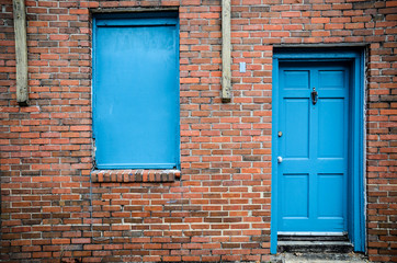 Blue door and windows, brick building, Treme, New Orleans