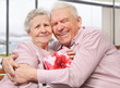 Smiling senior couple hugging