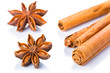Anise stars and cinnamon sticks over white background
