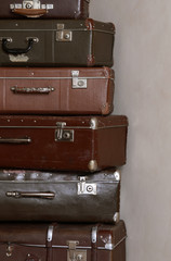 Old retro suitcases at a wall