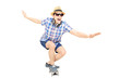 Excited guy with cap and sunglasses skating on a skate board