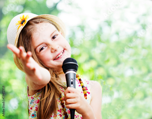 pretty little girl with the microphone in her hands - outdoor - 59402958