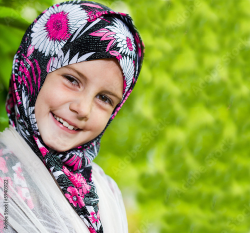 Little muslim girl portrait outdoor