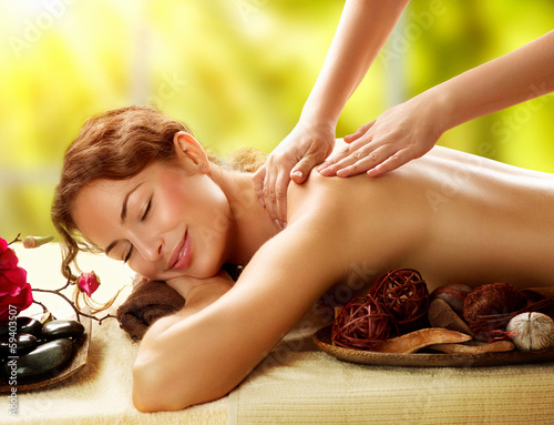 Spa. Beautiful Woman in Spa Salon getting Massage