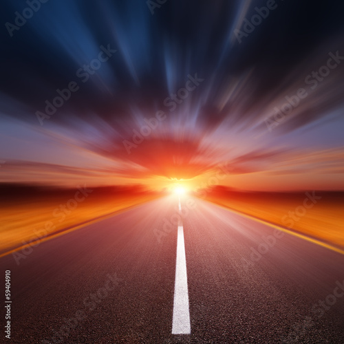 Motion blurred empty asphalt road