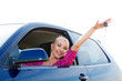 Happy car driver woman showing new car keys