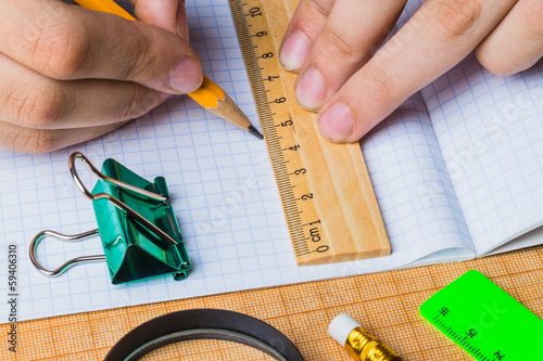 draftsman draws on a ruler