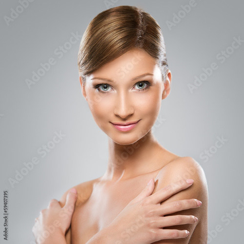 Beautiful young woman with perfect skin