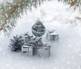 Christmas background with gifts on snow