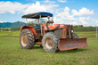 tractor in summer on field