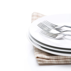tableware- plates and forks, isolated, selective focus