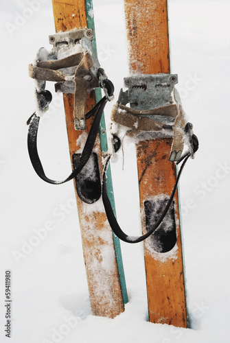 old wooden skis in the snow