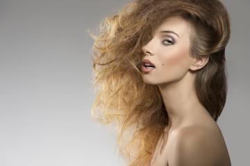 girl with bushy  hair-style