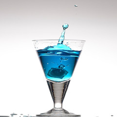 Splashing blue cocktail